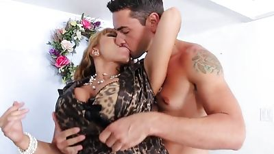 Busty mom giving head to her boy friend