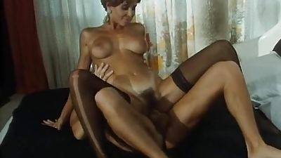 Lengthy legged redhead in activity with lovely tits