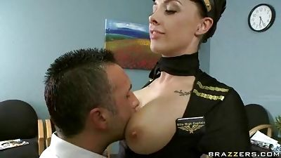 Huge-chested airline stewardess