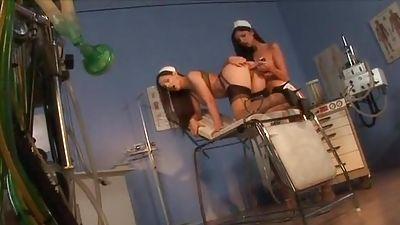 Lezzie Nurses in hot lingerie dildofucking