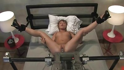 Jesse spreads gams to be manhandled by a machine