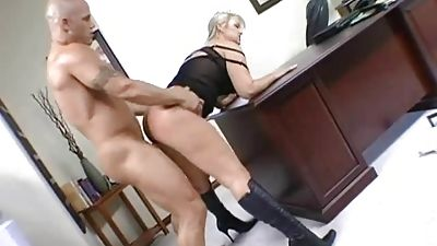 Abbey Brooks arched over the desk fucked